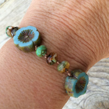 Hand knotted blue hawaiian flower bracelet czech glass with sterling silver and bronze accents