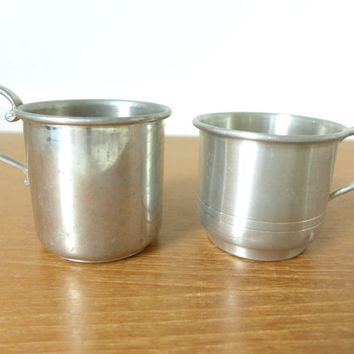 Two solid pewter children's mugs, Revere and Selandia