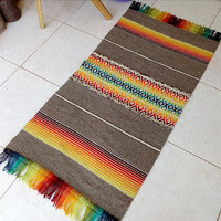 Handwoven colorful boho rug - wool rug in red, yellow, orange, green, blue and natural grey and white with wool tassels/fringes