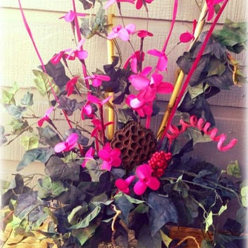 Floral Arrangement thats sure to make  statement.  Antique Ceramic Pot filled with ivy and Pink accents.