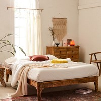 Andrea Carved Platform Bed | Urban Outfitters