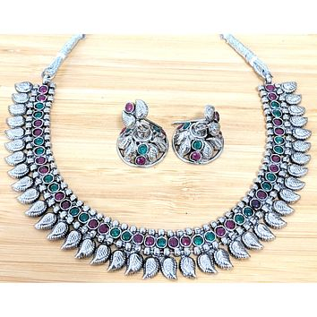 Oxidized simple polki stone embedded choker Necklace and small jhumka Earring set - curvy leaf design