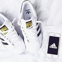 """Adidas"" Shell-Toe Stylish Women Men Causal Flats Sport Shoes Sneakers White( Black Line Golden Logo) I"