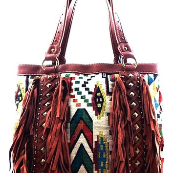 Featuring Navajo print on tapestry main fabrication, leatherette piping accent, two of genuine leather fringe at front panel and antique gold-tone studded embellishments, wide open top with zipper closure, one interior zipper divider at center, one interio
