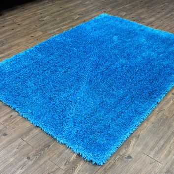 Hand Made Solid Turquoise Shag Area Rug with two inch Pile Size 5' X 7'