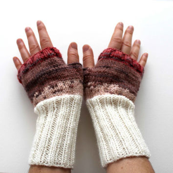 Autumn trend . This hand knitted fingerless glove. Batik desing. Cream, brown, pink and red. Trending items.