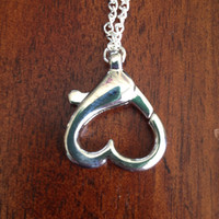 Ring holder necklace with heart pendant