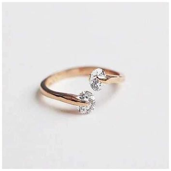 Match Made In Heaven - Two Diamonds have come together on a Gold Overlay Sterling Silver Ring