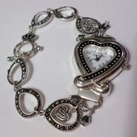 Women's silver and black heart watch bracelet with a designer black and silver chain and heart charms.