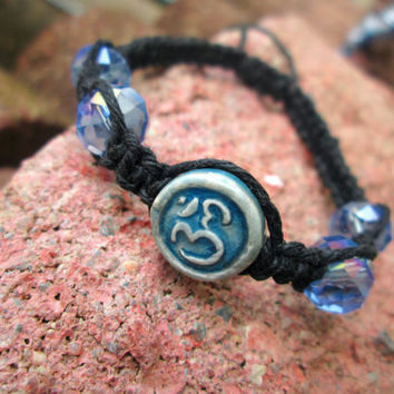 Raku Ohm Symbol Bead, Blue and Black, Glass Bead, Black Hemp Yoga Bracelet