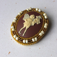 Flower fairy cameo brooch, fantasy theme pin, brown, yellow, ivory, romantic