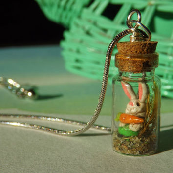 Tiny mini bunny with a carrot in a miniature bottle by zzzengirl