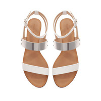 FLAT SANDALS WITH METALLIC PLATE - Flat sole sandals - Shoes - TRF | ZARA United States