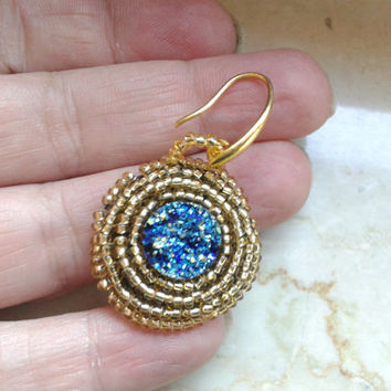 handmade bead embroidery earrings of a synthetic druzy cabochon and gold color seed beads