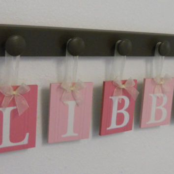 Pink Nursery Decorations Wooden Letters. Set Includes 5 Brown Pegs and Custom Baby Name LIBBY Painted in Pinks Personalized Baby Gift