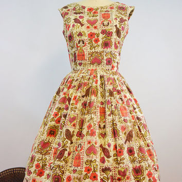Vintage 1950s Novelty Print Dress with Full Pleated Skirt and Criss Cross Back