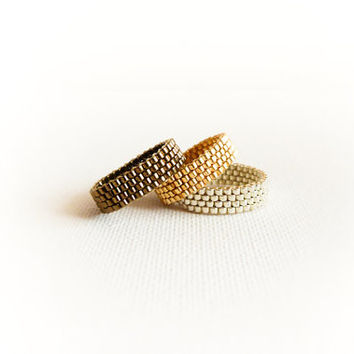 Set of 3 stack rings in gold silver bronze. Metallic seed bead jewelry. Modern minimalist band ring.