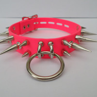 lockable pink pvc bondage fetish slave collar 24mm wide with 15mm and 30mm spikes and a 25mm chrome ring