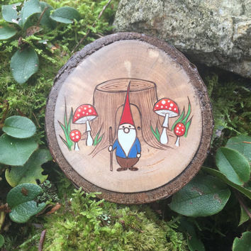 Wood burned and painted gnome with a tree stump with mushrooms. Woodland wall hanging, ornament or magnet