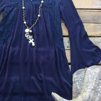 Our Used To Love Him Tunic Dress - Navy would be so cute for any occasion! It's a bell sleeve dress with see through lace panels and scoop neckline with a tie string across the top of the back. Unlined so we suggest wearing a cami underneath for coverage.
