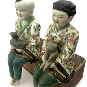 Chinese Porcelain Famille Rose Figures, Seated Man Holding a Bird & a Woman Holding a Cat, Floral Pattern Robes, Vintage Ceramic Couple