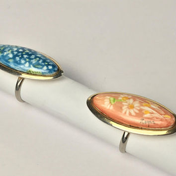 Set of Two Hand Painted Rings / Long Oval Gold Tone Rings / Orange and White Daises / Blue Watercolor Flowers / Vintage Signed Royce Ring