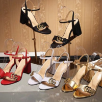 Gucci female sandal with a pair of sandals