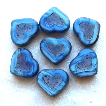 Six Czech glass heart beads; 14 x 12mm table cut, carved, opaque marbled blue hearts with a silver picasso finish C6906