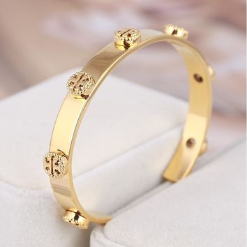"""Tory Burch""New Fashion Women Hollow Letter Stainless Steel Texture Bracelet Golden I13029-1"