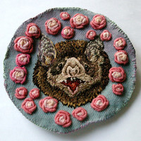 hand-embroidered rosey vampire bat applique
