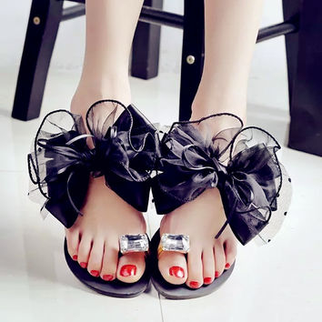 Bowtie flower flat sandals
