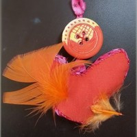 Feather, heart and button wall hanging by Alexandra Cook