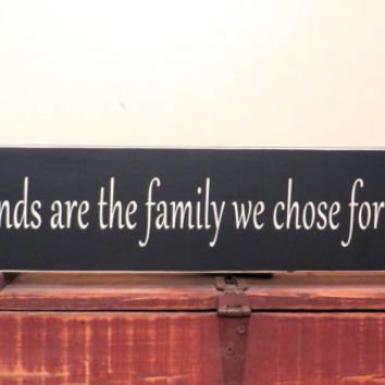 "Friendship sign Our friends are the family we chose for ourselves stained in black.  Measures 4 1/2"" x 24"" long made from knotty pine"