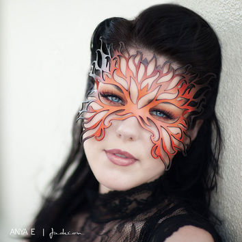 Filigree Flame leather mask in shades of orange by TomBanwell