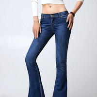 Blue Flared Jeans With Raw Hem