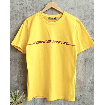 motel - oversize basic tee - hate mail - yellow