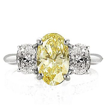 A Stunning Canary Yellow 3CT Oval Cut Sapphire Three Stone Engagement Ring