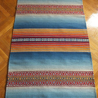 Hand woven wool rug - made to order - blue and orange colors