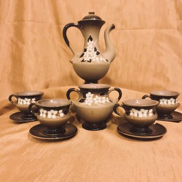 Vintage miniature hand painted clay teapot sugar bowl and 4 teacups and saucers