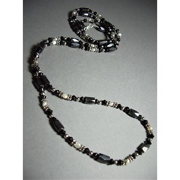 Hematine 5 mm Wide Faceted Cylinder and Freshwater Pearl Seed Bead Necklace 36'' Long