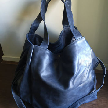 Gigi bag, huge sized leather tote bag with strong handles with clips that keep it compact.Fits everything, makes the best travel or baby bag