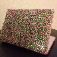 Pink and green MacBook Pro 13in case