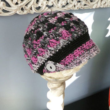 Bobbled woman's newsboy hat in pinks, grays & black with fold-up corner brim and silver buttons