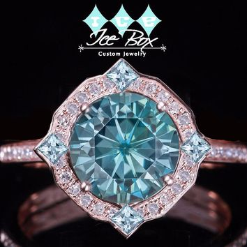 Caribbean Blue Moissanite Ring 2ct. 8mm Blue Round Brilliant set in an 14k Rose Gold Diamond and Aquamarine Halo Setting