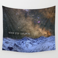 Never stop exploring mountains, space..... Wall Tapestry by Guido Montañés