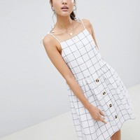 ASOS DESIGN Button Through Check Mini Sundress at asos.com
