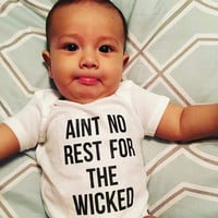 Aint no rest for the wicked quote baby Onesuit for boys and girls