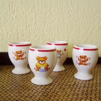 Vintage white egg cups, set of four, Soviet era, china cups with teddy bears illustrations, red rimmed, white ceramic egg cups, early 60's