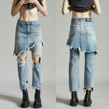 The new hole tassel loose short skirt jeans fake two - piece