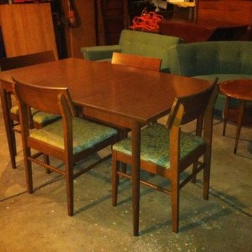 Mid Century Table (1) leaf and Four Chairs.